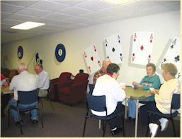 Seniors enjoy cards in the Game Room